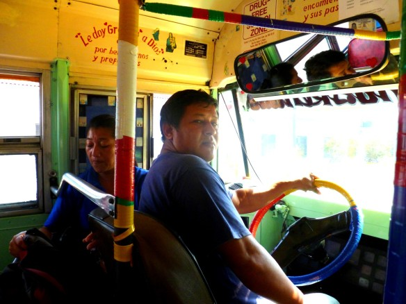 The legendary chicken bus driver in his colourful retired US school bus, AKA chicken bus.